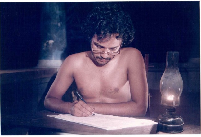 Kathapurushan - Kunjunnii writing (lamp before)